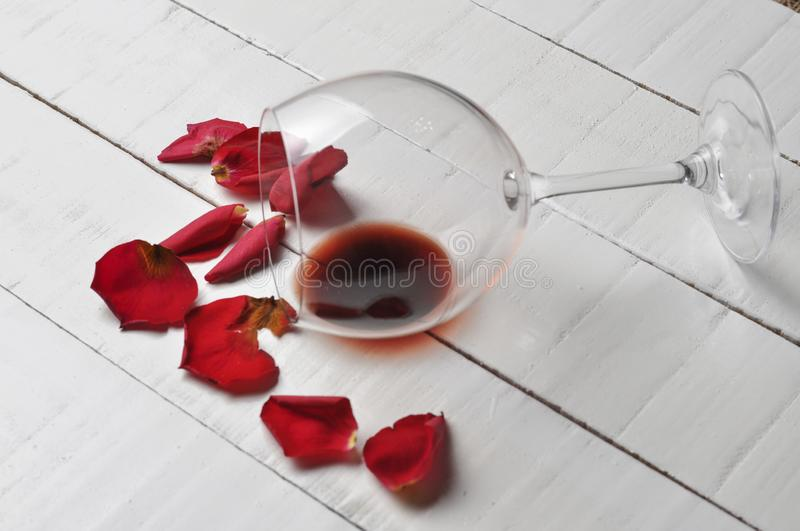 Wine glass and beautiful red rose isolated on white background. petals rose.Copy space royalty free stock photo