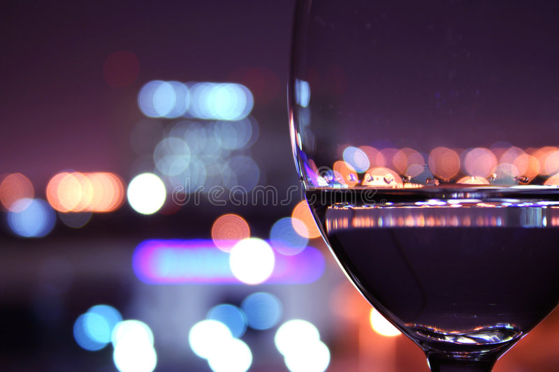 Wine glass with blurred lights. Wine glass with a city view of lights