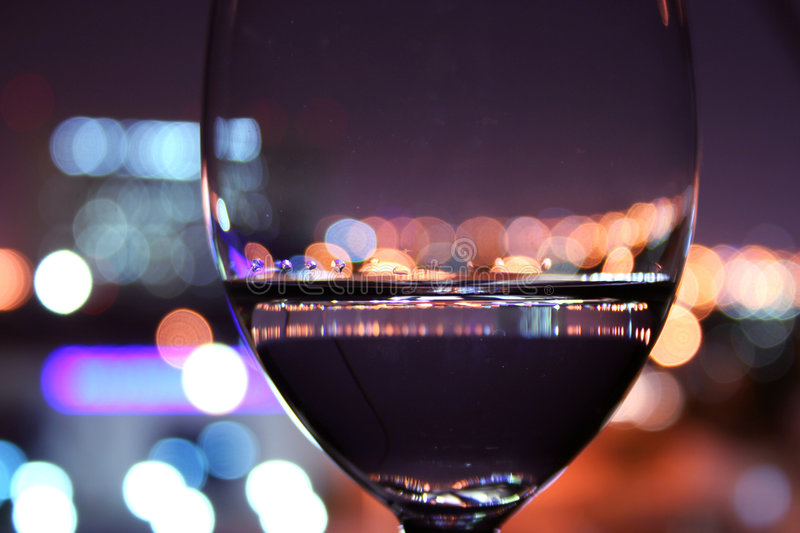 Wine Glass with blurred lights. Luxurious wine glass in a romantic setting