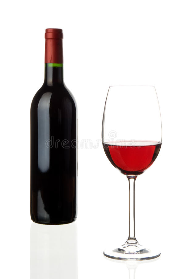 Wine glass with bottle. A glass of red wine with an unlabeled winebottle in the background isolated on white, studioshot royalty free stock photography