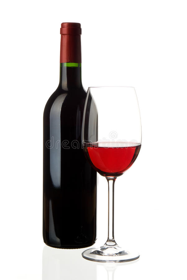 Wine glass with bottle. A glass of red wine with an unlabeled winebottle in the background isolated on white, studioshot