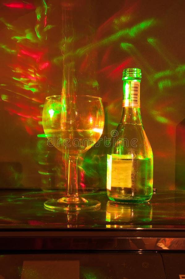 Wine glass and bottle abstract glowing pattern. A wine glass and bottle with light painting techniques from some laser lights royalty free stock photos