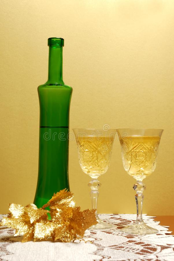 Wine glass and bottle of wine royalty free stock image