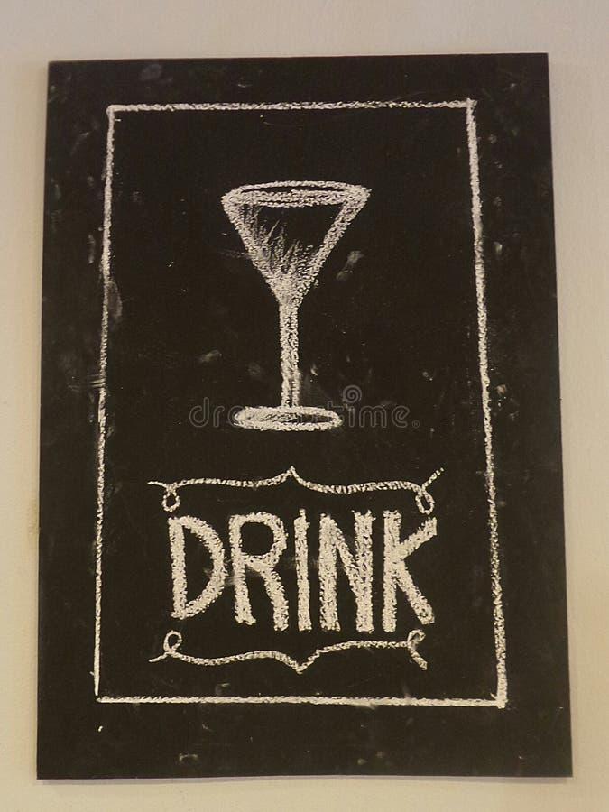 Wine glass chalk drawing on blackboard. Wine grass with drink writing on blackboard royalty free stock image