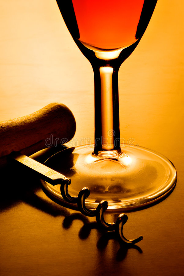 Wine glass and corkscrew stock photos