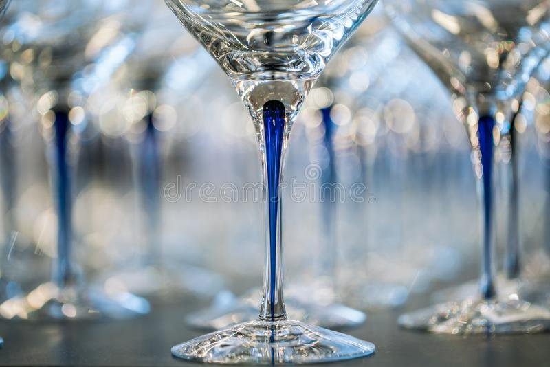 Wine Glass at the exhibition on the table. wedding decor. Ation pattern alcohol drink empty line celebration restaurant bar row white wineglass catering party royalty free stock photos