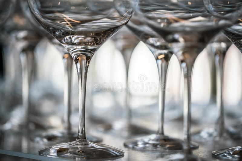 Wine Glass at the exhibition on the table. wedding decor. Ation pattern alcohol drink empty line celebration restaurant bar row white wineglass catering party royalty free stock images