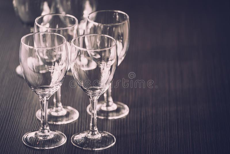 Wine Glass at the exhibition on the table. wedding decor. Ation pattern alcohol drink empty line celebration restaurant bar row white wineglass catering party stock photography