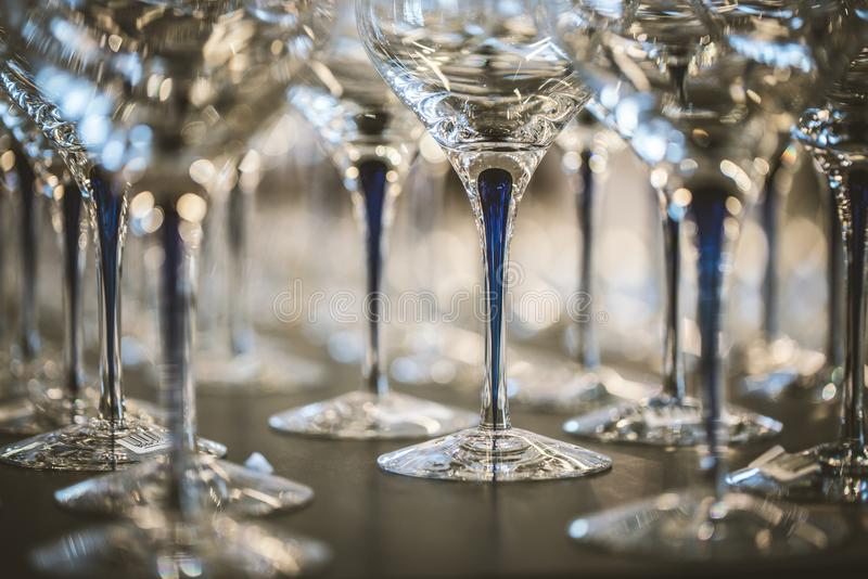 Wine Glass at the exhibition on the table. wedding decor. Ation pattern alcohol drink empty line celebration restaurant bar row white wineglass catering party stock image