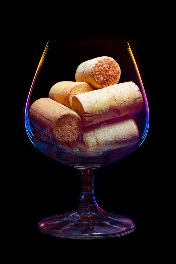 Download A Wine Glass Filled Corks With Lighted Multi-colored Gradient Stock Photo - Image of collection, alcoholic: 105165192