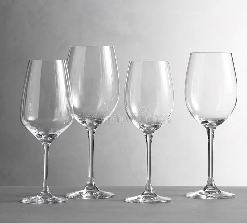 Wine glass in front of fireplace , Santino Wine Glasses royalty free stock images