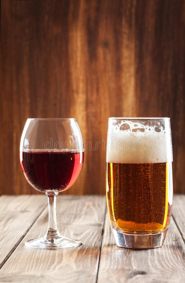Wine glass and glass of beer. Red wine glass and glass of light beer stock images
