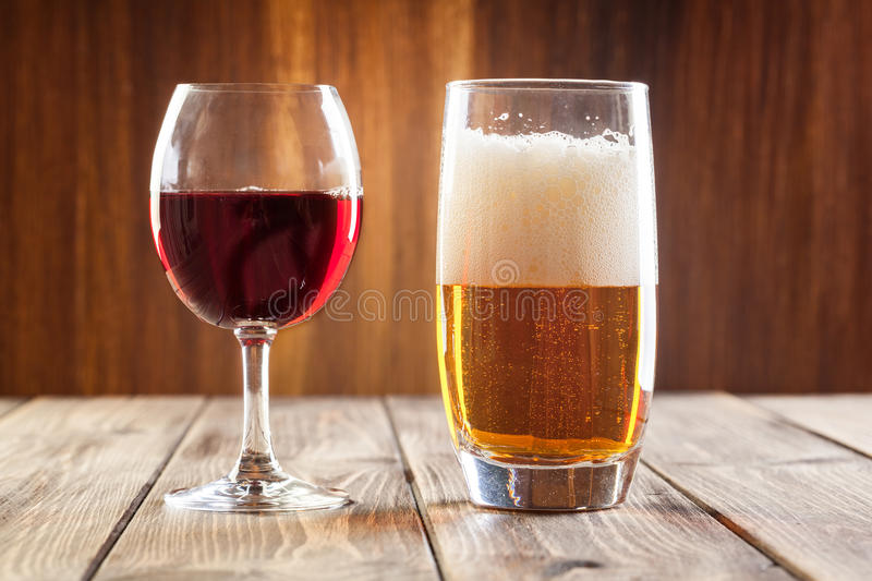 Wine glass and glass of light beer. Red wine glass and glass of light beer royalty free stock image