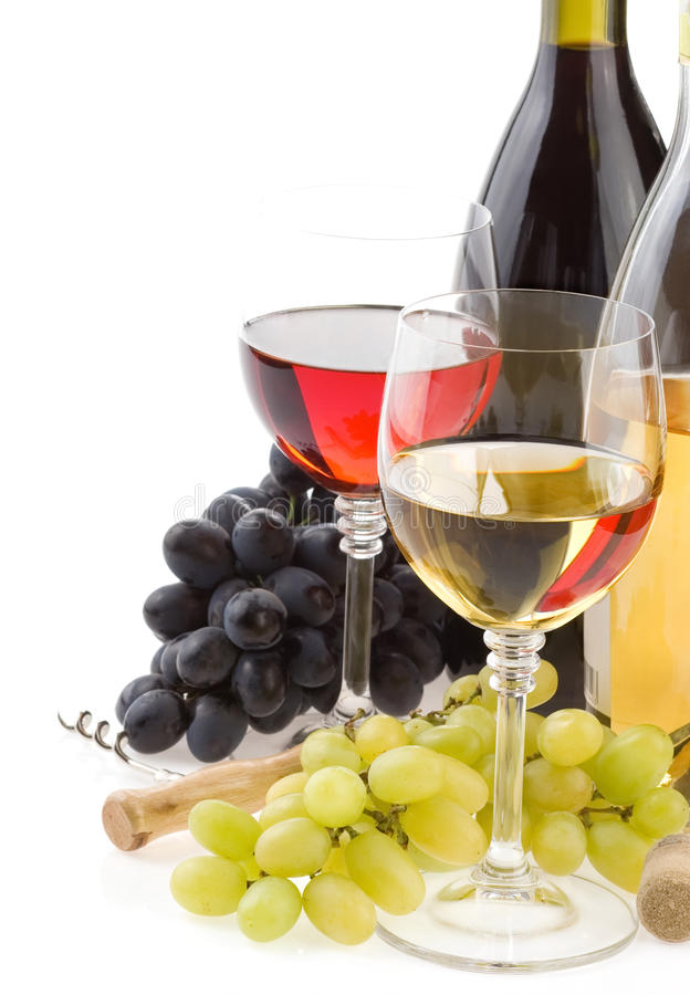 Wine in glass and grape fruit on white royalty free stock images
