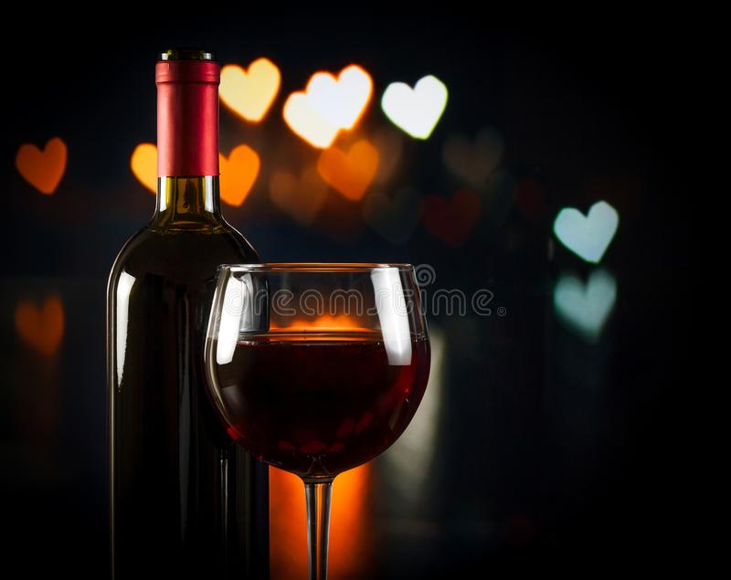 Wine glass near bottle, concept of valentine's day stock photo