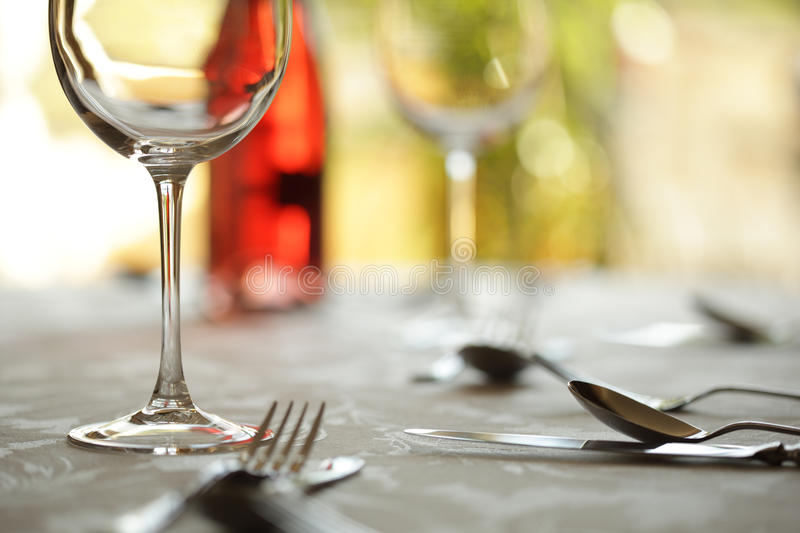 Wine glass and place setting in a restaurant royalty free stock images