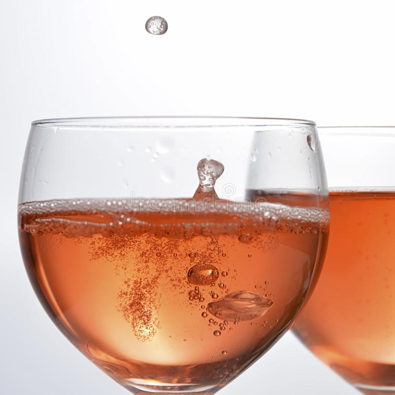 Wine glass with red sparkling drink royalty free stock photo