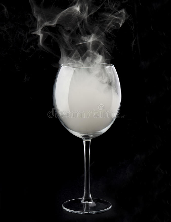 Wine glass and smoke stock photos