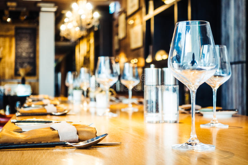 Wine glass on table. In restaurant - Vintage Filter royalty free stock photo