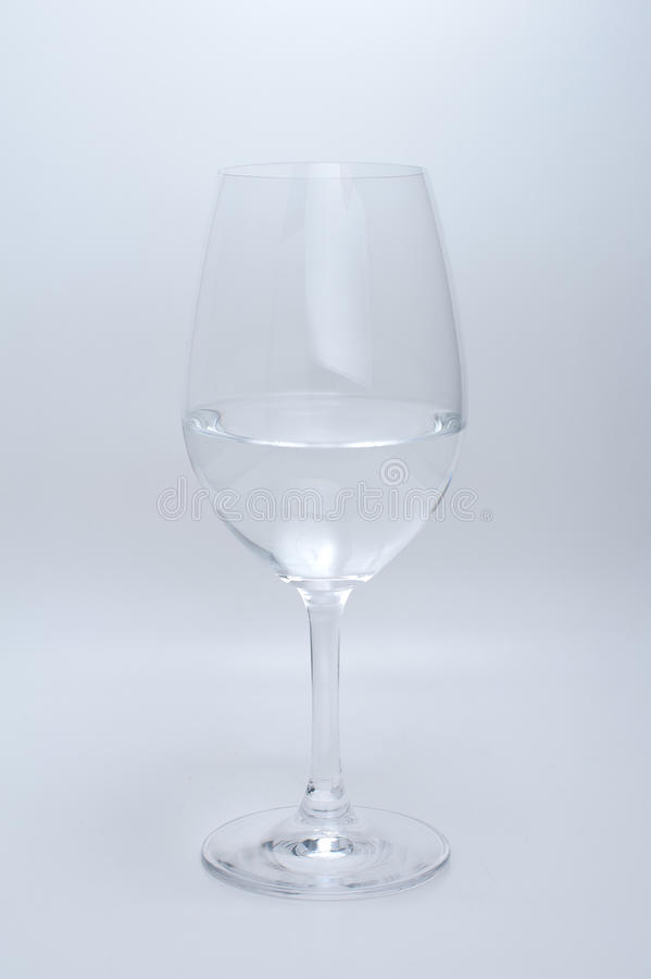 Wine glass with water on white background stock image