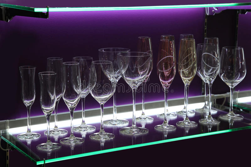 Wine Glasses. On the Shelf with Violet Illumination stock photos