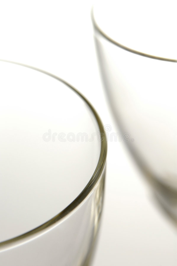 Wine Glasses. High key picture of two wine glasses on white background royalty free stock images