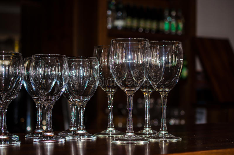 Wine Glasses on Bar stock photo