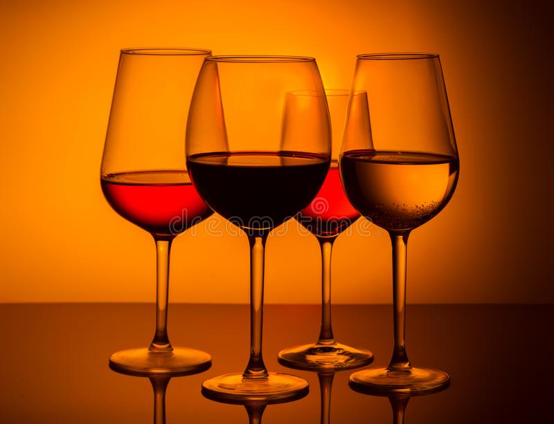 Wine glasses on blue royalty free stock photo