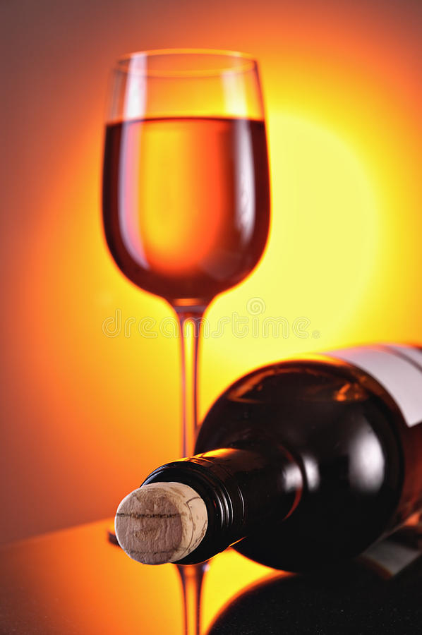 Wine in glasses and a bottle stock photography