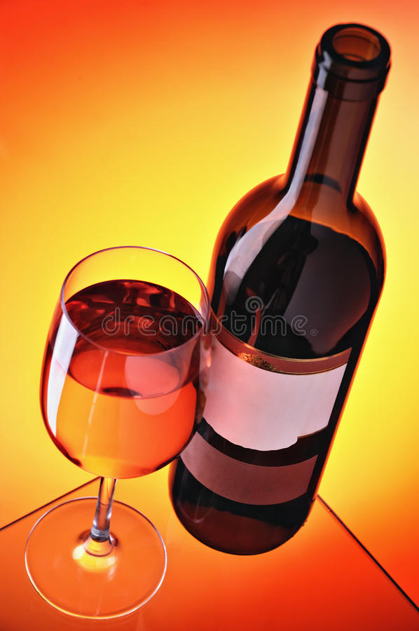Wine in glasses and a bottle royalty free stock photos