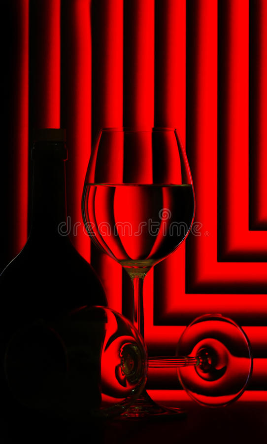 Wine glasses and bottle on red royalty free stock photo