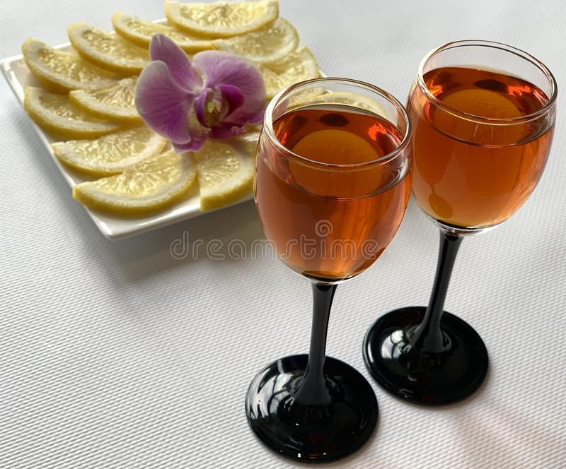 Wine glasses with cognac and lemon with sugar. Holiday, beautiful dishes. royalty free stock photography