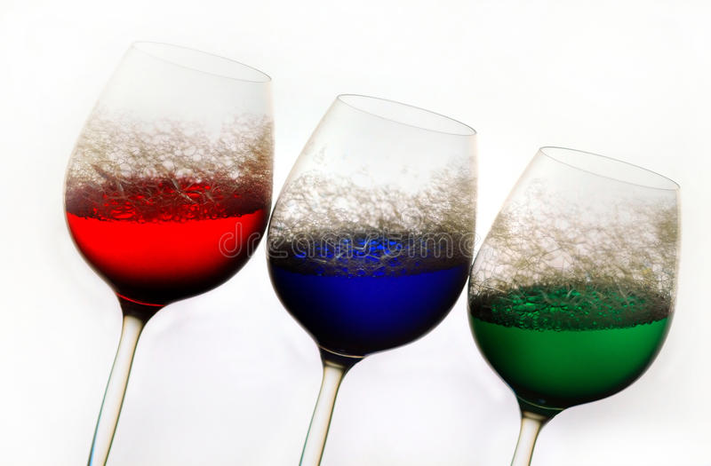 Wine glasses colored water royalty free stock photography