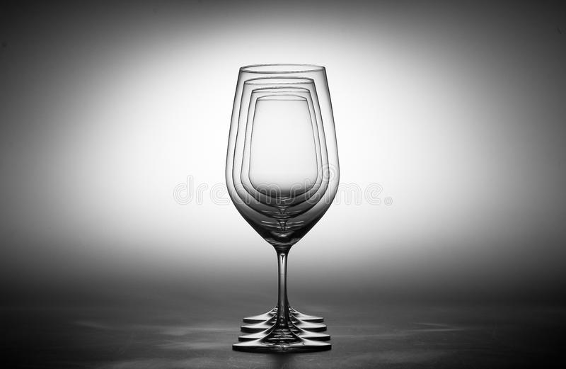 Wine glasses. Empty wine glasses aligned on a gray background royalty free stock image