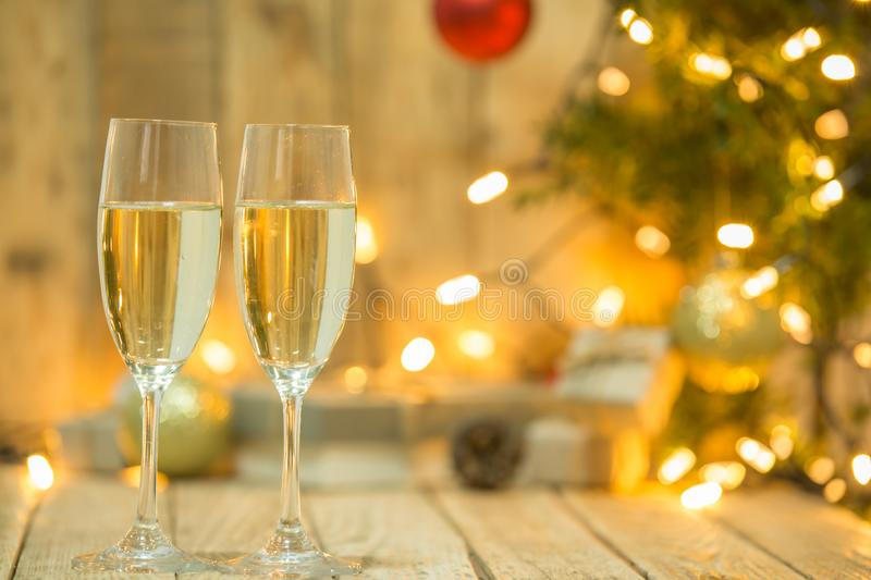 Wine glasses in front of a Christmas tree stock images