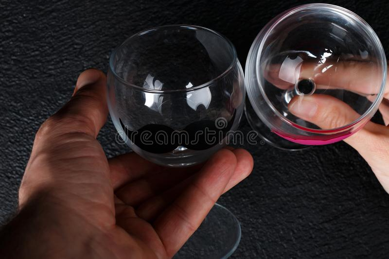 Wine glasses in hands stock photos