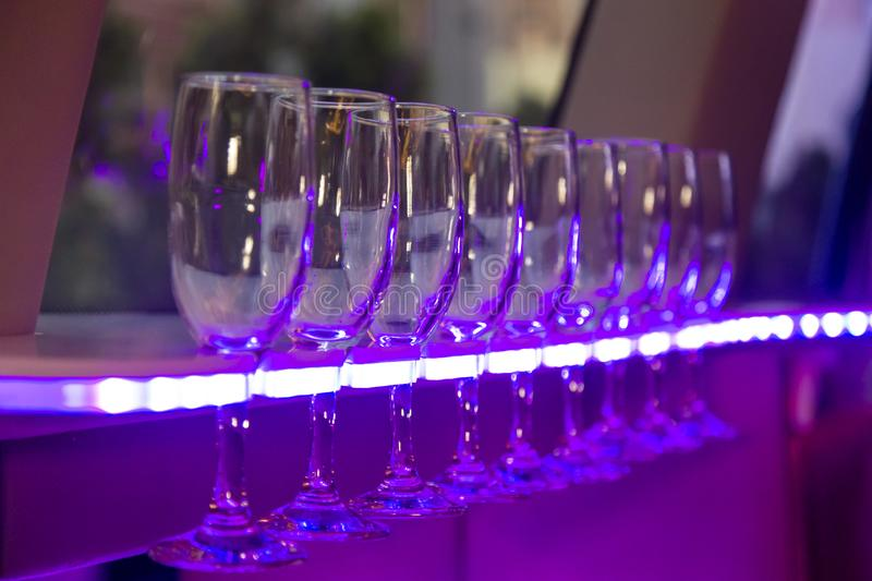 Wine glasses in the limmusine with backlight stock photography