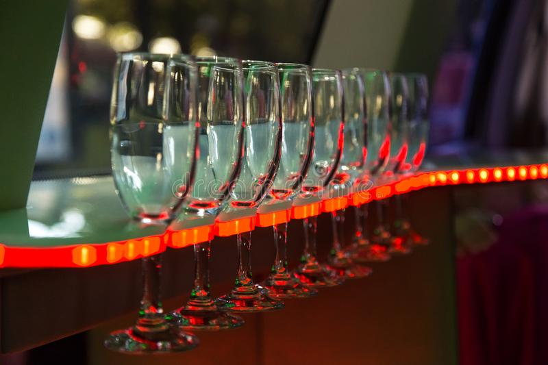 Wine glasses in the limmusine with backlight 2 stock photo