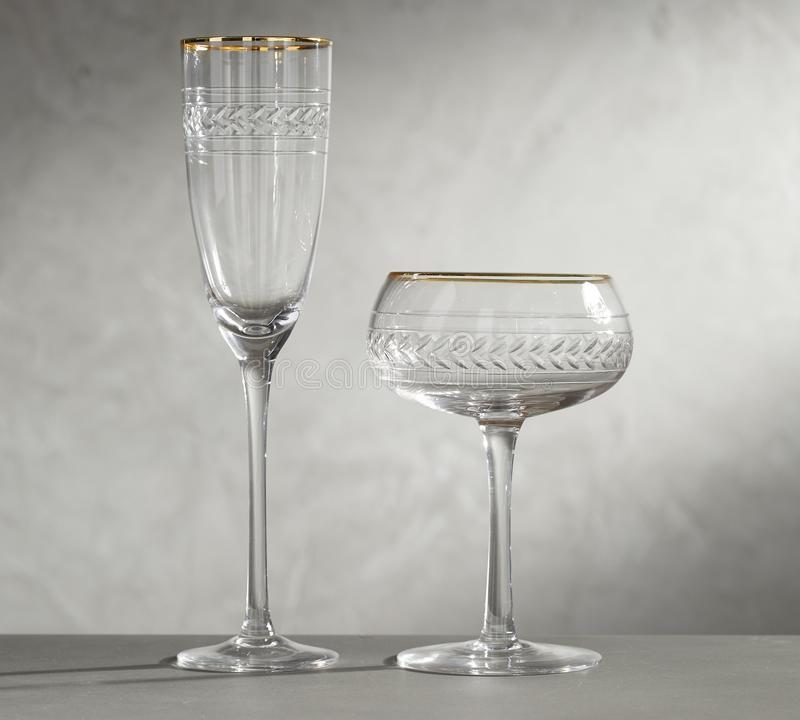 Wine Glasses. One glass with empty and yellow wine, royalty free stock photo