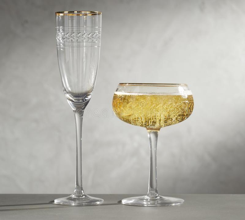 Wine Glasses. One glass with empty and yellow wine, stock photos