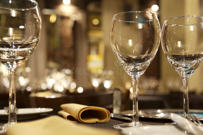 Wine glasses on restaurant table royalty free stock images