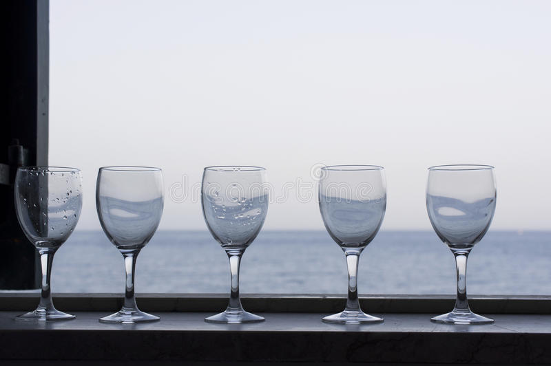 Wine Glasses And Sea stock images
