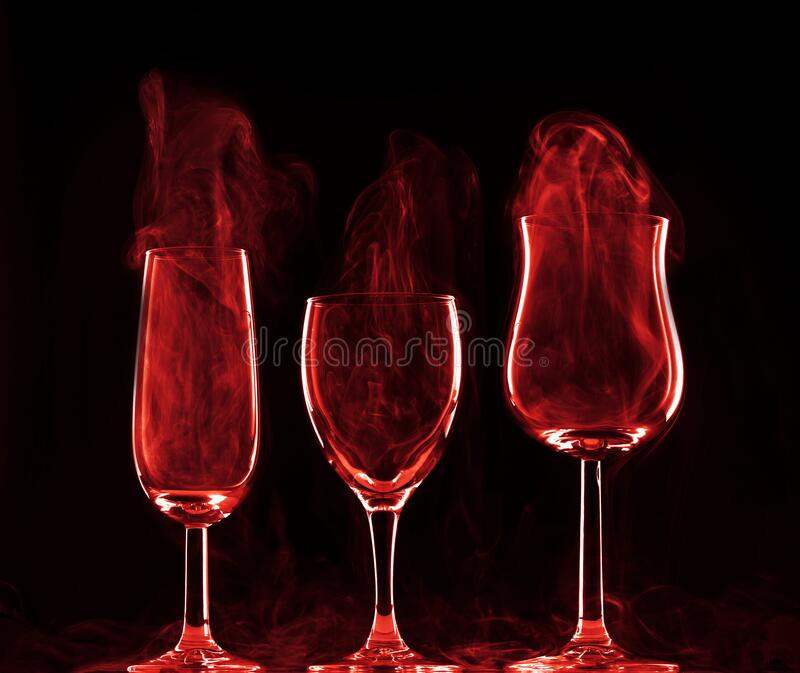 Wine glasses with smoke royalty free stock image