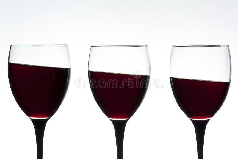 Wine glasses on a tilt stock images