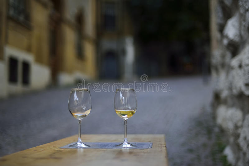 Wine glasses for two lovers on the streets of Neuchatel. Switzerland stock photo