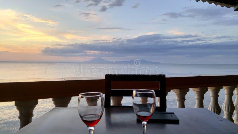 Wine glasses and volcano views stock photos