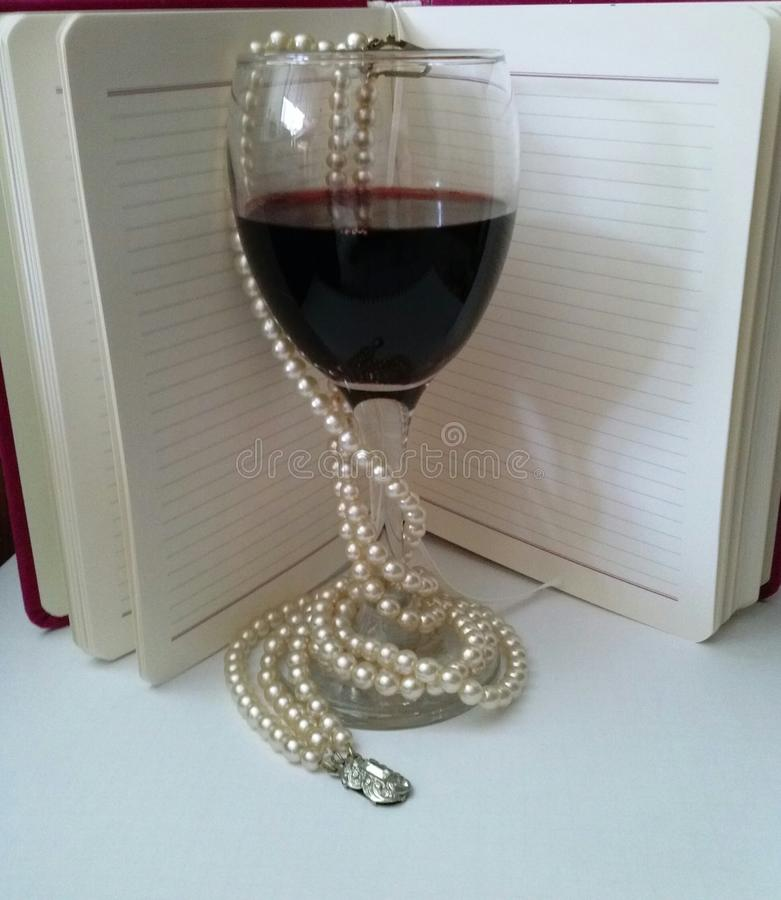 Wine. With a good red wine comes inspiration for writing royalty free stock images