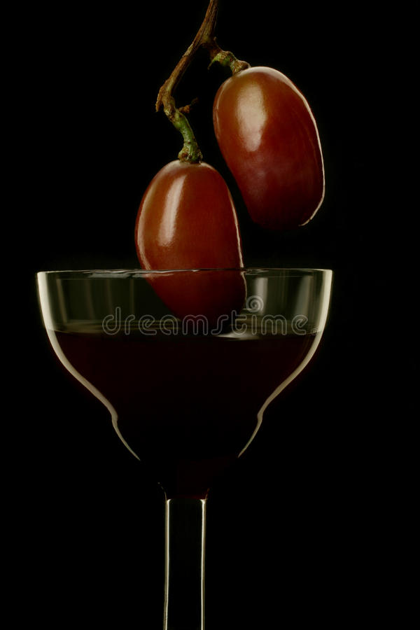 Wine and grape on black background stock image