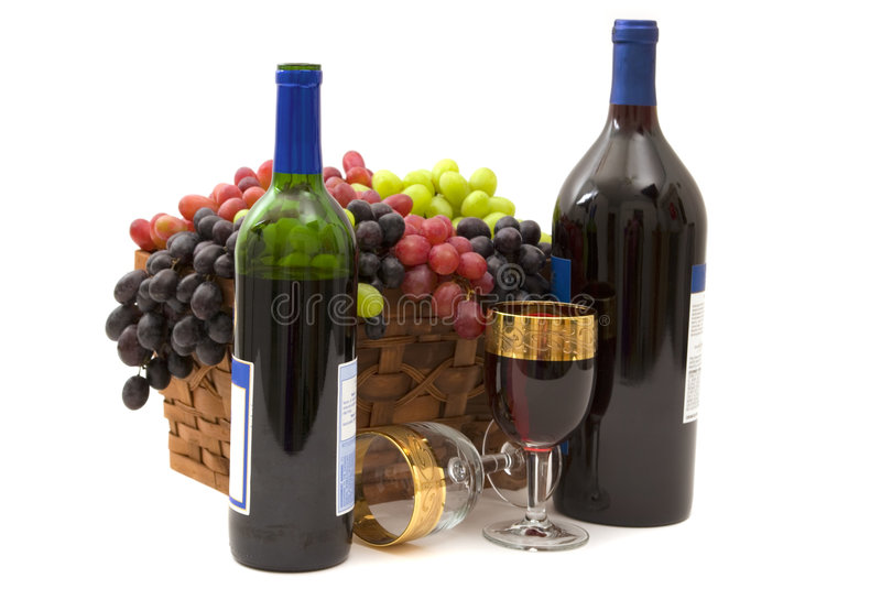 Wine and Grapes. Red wine and three different kinds of grapes in a basket stock photos