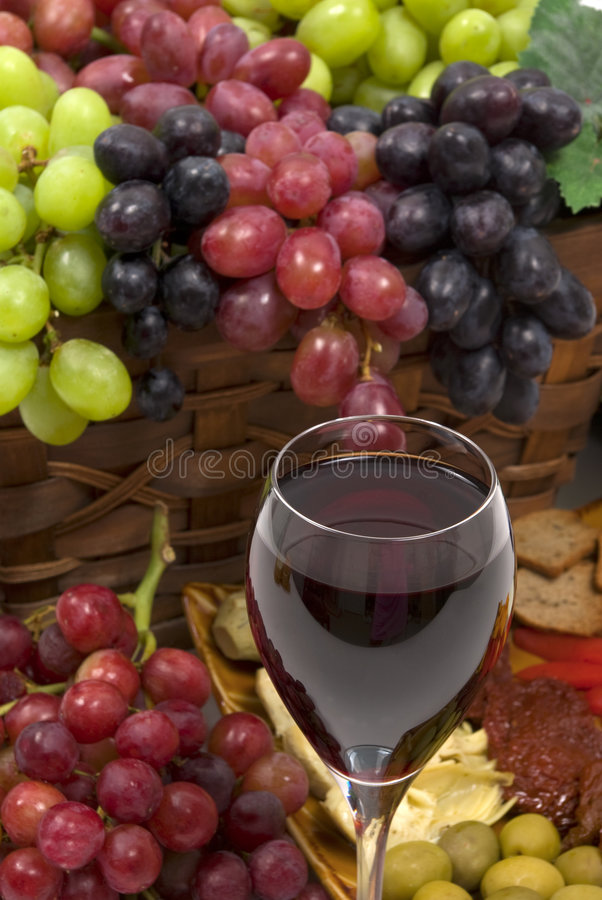 Wine and Grapes. Three different kinds of seedless grapes and wine